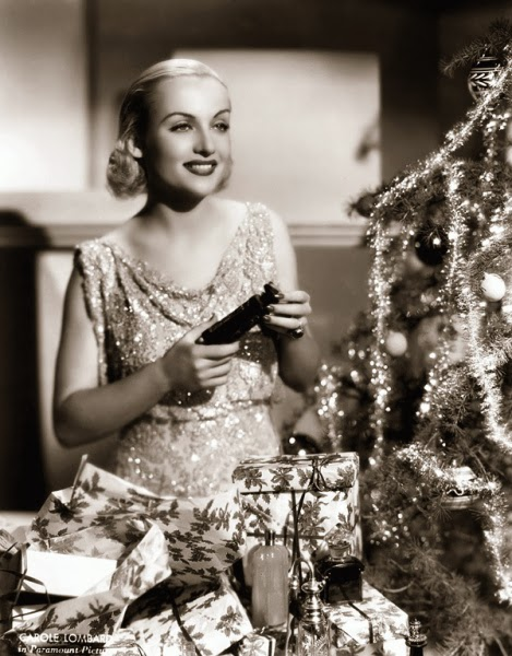 Carole Lombard opens her Christmas presents